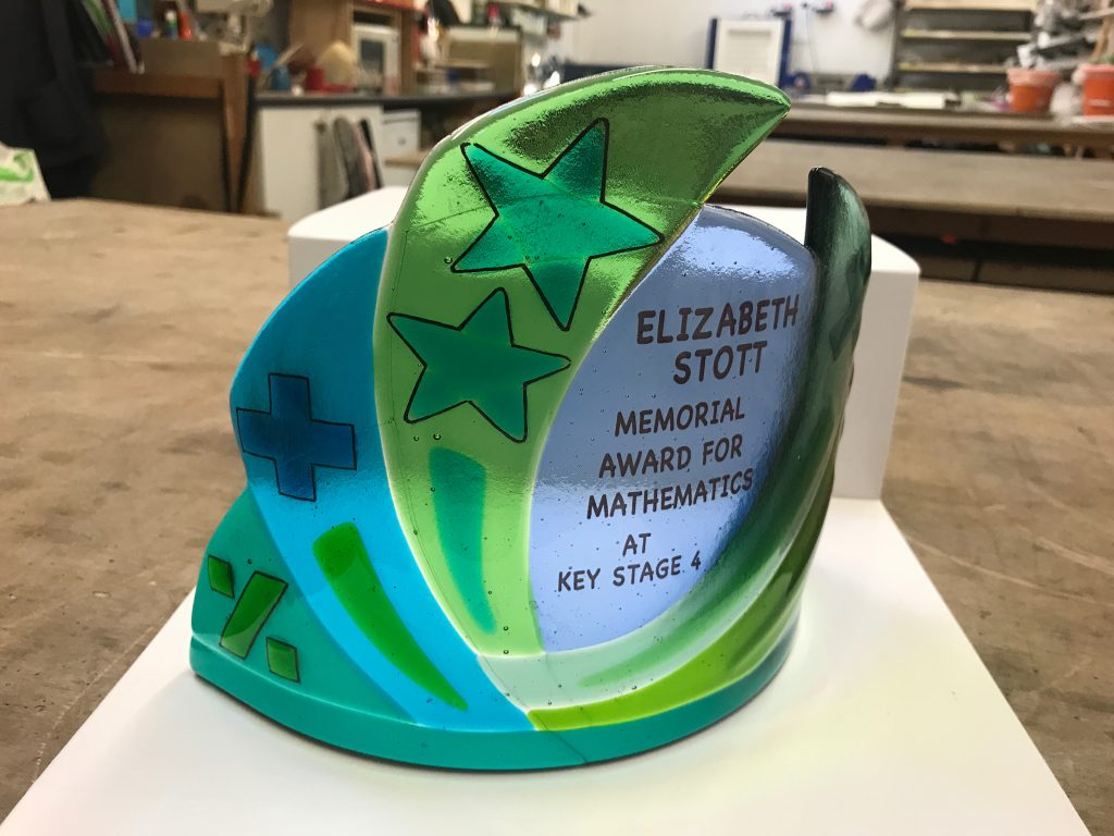 A commemorative fused glass trophy for a maths award