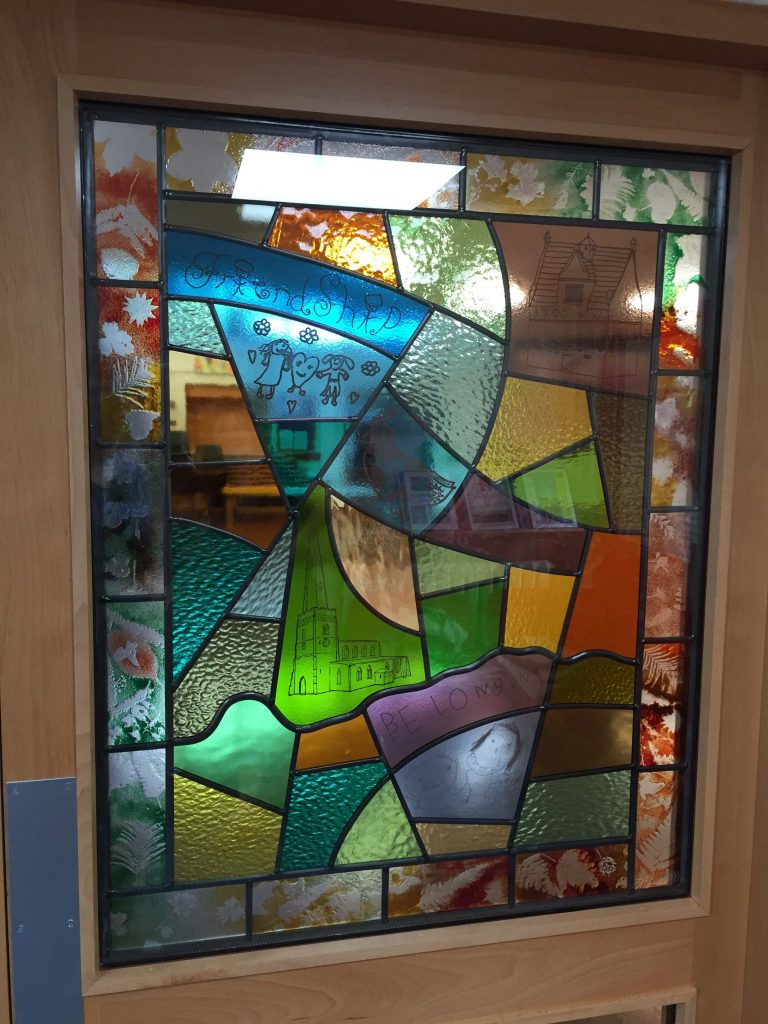A detail showing some of the drawings done by pupils and members of the community that have been decaled onto the windows