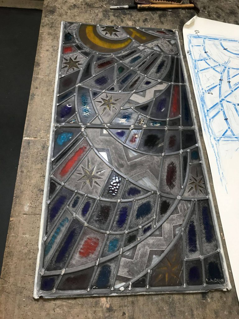 A damaged stained glass window