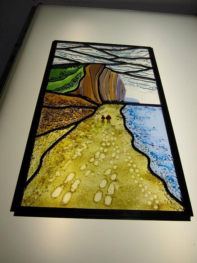 A fused glass and leaded triple glazed unit based on a seaside scene.