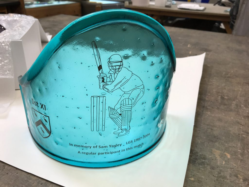 A commemorative fused glass trophy