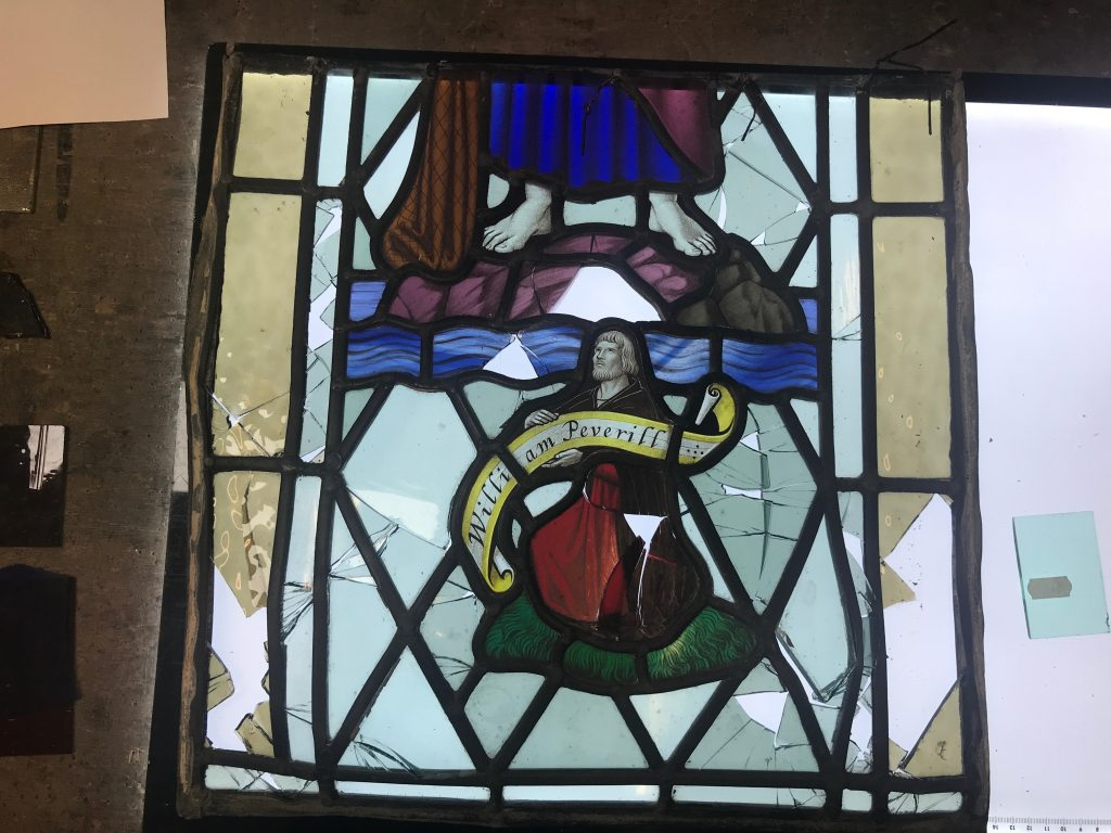 A broken stained glass window