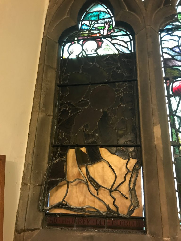 The damaged stained glass window at a St Mar Magdalen, Leicester