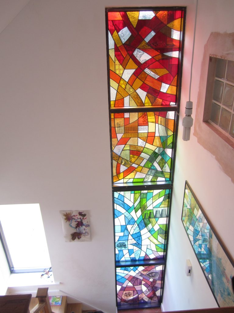A set of four triple glazed stained glass windows for the full height stairwell in an extension in hathern