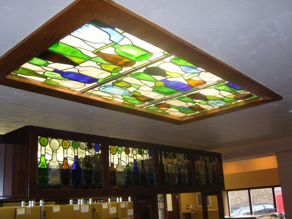 One of three ceiling panels using flattened bottles.