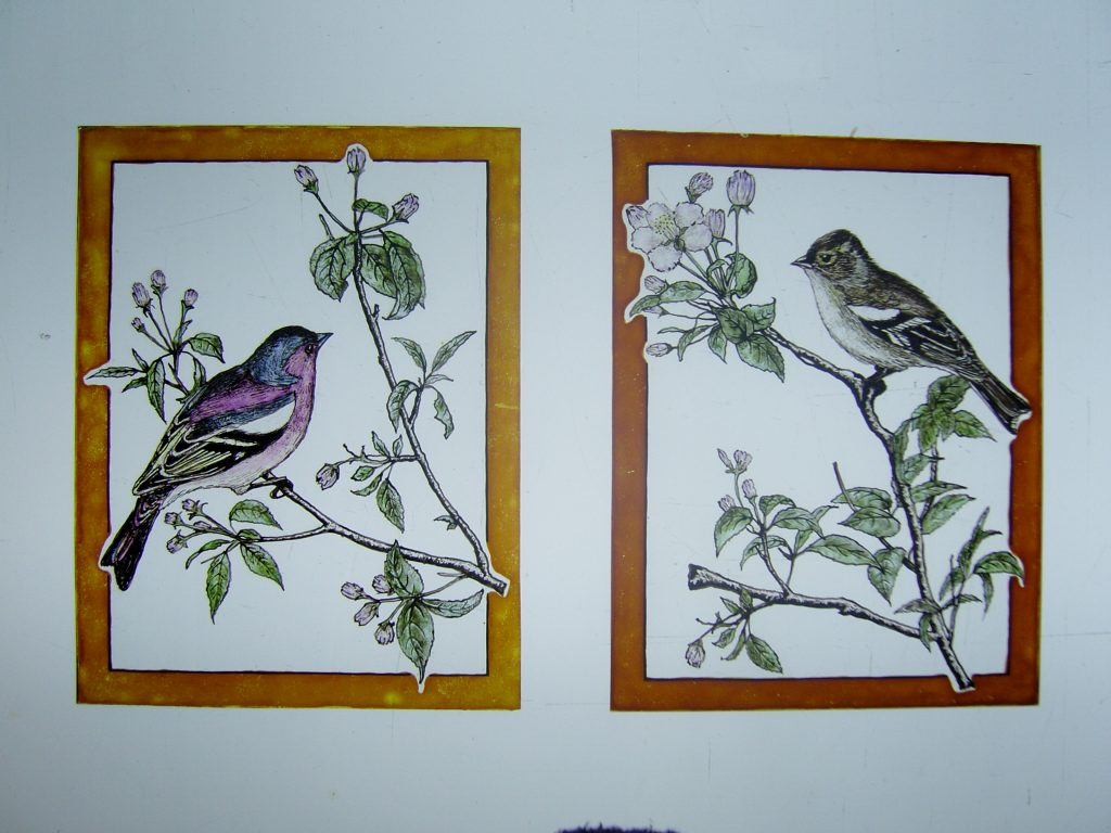 A pair of handpainted birds for a front door panel.