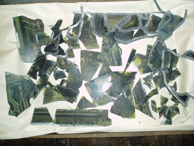 A pile of broken pieces collected froma damaged stained glass window