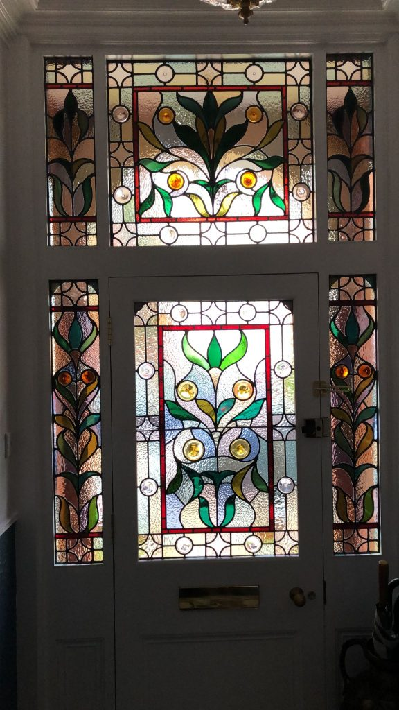 A restored set of leaded lights in a front door